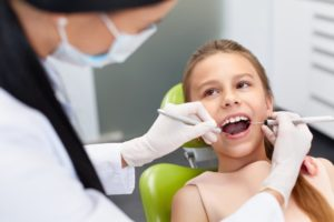 A child at her dental appointment.
