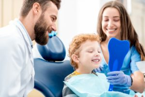 Child with dentist and parent