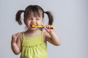 Cute little girl practicing great children's dental health